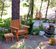 a chair and fountain within our Contemplative Garden